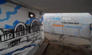 """Publiskās ārtelpas objekts. Sienu gleznojums """"Tā daļa Rīgas"""" gājēju tunelī zem dzelzceļa Rīgā, starp Ģertrūdes un Daugavpils ielām. Pasūtītājs Rīgas Austrumu izpilddirekcija. Sienu gleznojuma skice māksliniece Sindija Kļaviņa."""